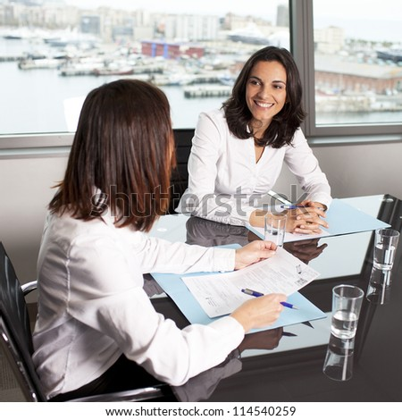 Insurance agent with client in a nice office - stock photo