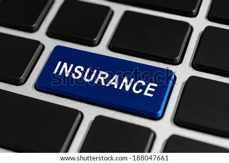 insurance blue button on keyboard, business concept - stock photo