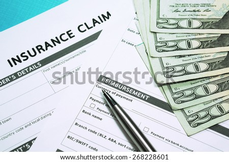 Insurance claim form with money for insurance concept