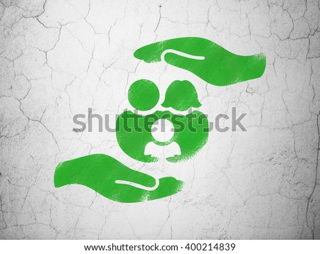 Insurance concept: Green Family And Palm on textured concrete wall background - stock photo