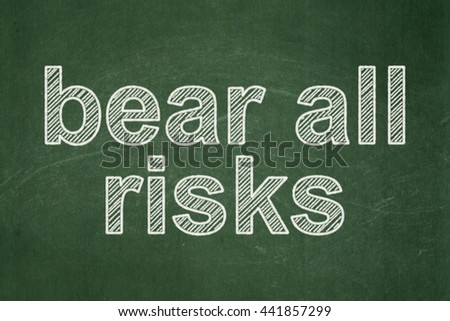 Insurance concept: text Bear All Risks on Green chalkboard background