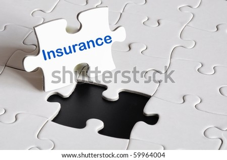 insurance concept with white puzzle or jigsaw - stock photo