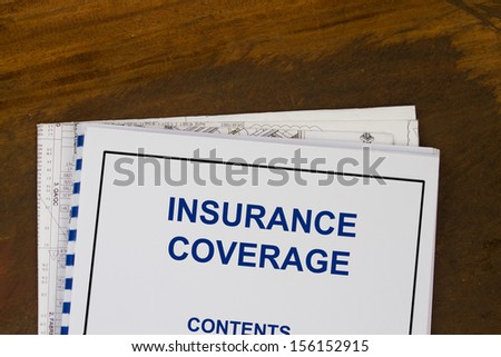 insurance coverage abstract with blueprints and coffee. - stock photo