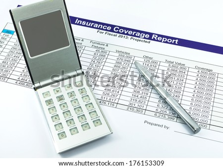 insurance coverage report with calculator and pen for business - stock photo