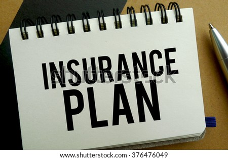 Insurance plan memo written on a notebook with pen