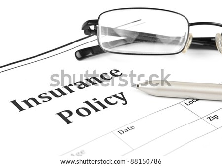insurance policy form on desk in office showing risk concept. Life; Health, car, travel