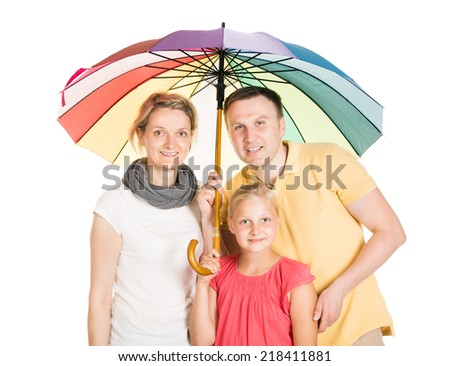 Insured Family Standing Under Umbrella. Isolated On White - stock photo