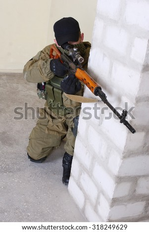 insurgent sniper with SVD rifle inside the building