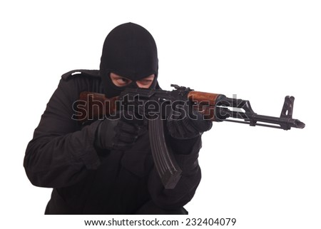 insurgent with AK 47 isolated on white background - stock photo