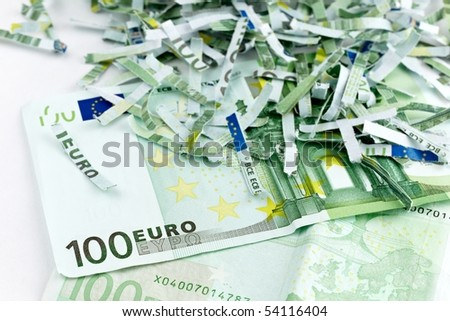 intact and shredded one hundred euro bills - stock photo