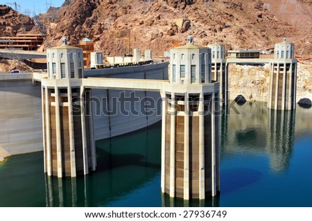 Intake towers of Hoover Dam on the Colorado River on the border of Arizona and Nevada. - stock photo