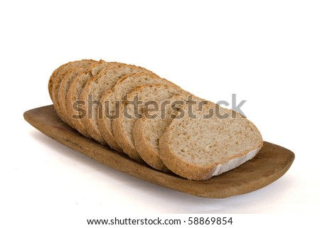 Integral bread on the wooden plate in isolated over white - stock photo