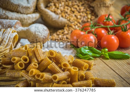 Integral pasta with ingredients ingredients and tomatoes. - stock photo