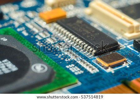 Integrated semiconductor chip / microprocessor on the blue circuit board representative of the high-tech and Informatics