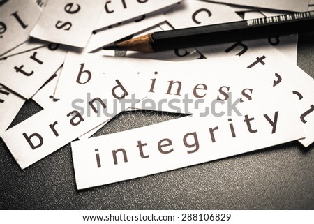 Integrity of brand, words in piece of paper in pile - stock photo