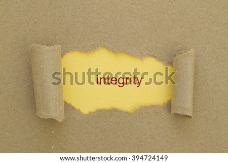 integrity word written under torn paper. - stock photo