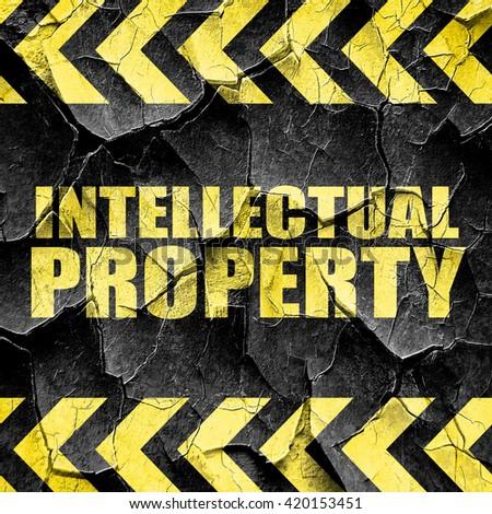 intellectual property, black and yellow rough hazard stripes - stock photo