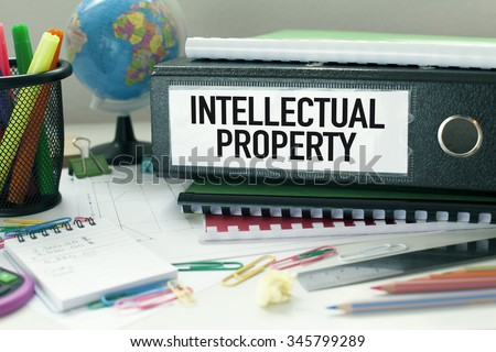 Intellectual Property  Conceptual background in office with files and papers - stock photo