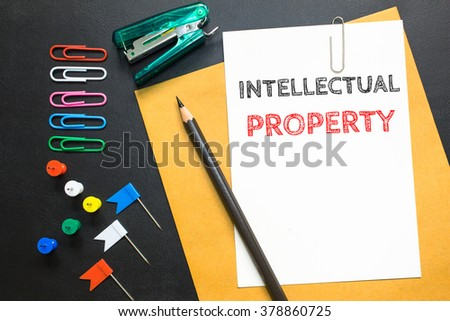 Intellectual property, message on the white paper / business concept - stock photo