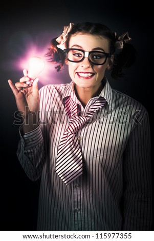 Intelligent Female Business Person Wearing Dorky Glasses Holding Lightbulb In A Smart Idea Concept - stock photo