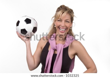 Intelligent 30s woman with soccer ball - stock photo