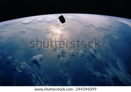 INTELSAT VI, a communication satellite was stranded in an unstable orbit after its March 1990 launch. Photographed in orbit from the Space Shuttle Endeavour. - stock photo
