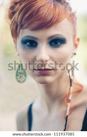 Intense beautiful red woman close up portrait. - stock photo