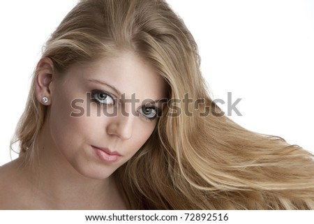 Intense close up of pretty teenage girl with big eyes and beautiful blonde hair - stock photo