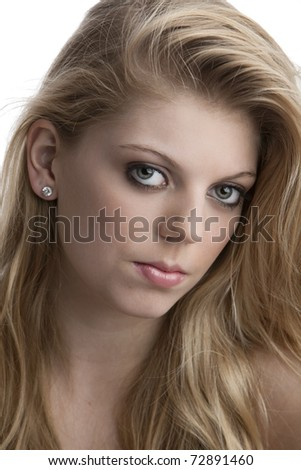 Intense close-up of pretty teenage girl with big green eyes