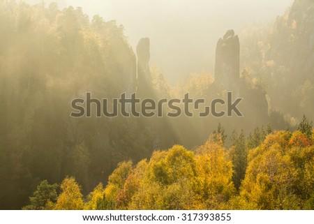 Intense evening light on colorful autumn trees in Saxony Switzerland - stock photo
