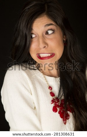 Intense facial expression on dark complected woman - stock photo