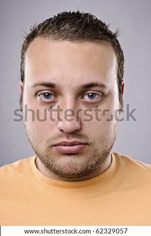 Intense portrait of overweight man, high detail - stock photo
