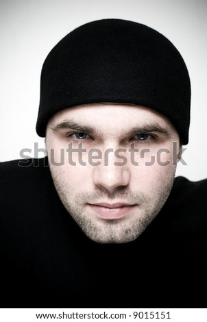 Intense portrait of young man - selective focus on the model's eyes. - stock photo