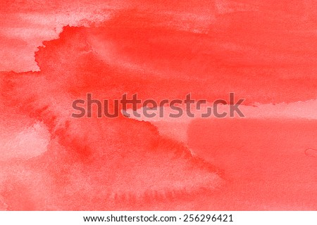 intense red watercolor on paper background - stock photo