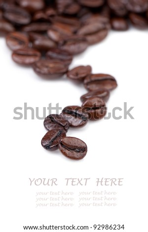 Intensely dark coffee beans.  Copy space for your text