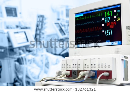 Intensive care unit with ECG monitor - stock photo