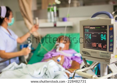 Intensive Care Unit with the patient - stock photo