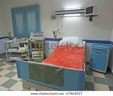 Intensive care ward in a medical center with monitoring equipment - stock photo