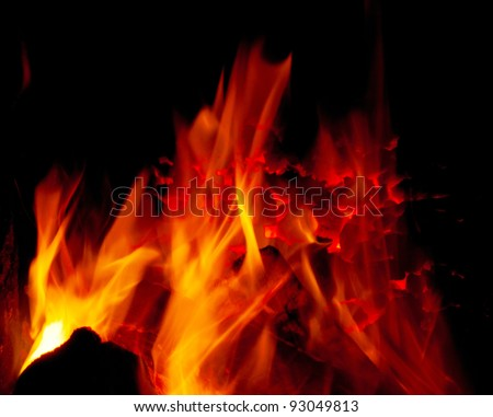 Intensively burning coal in a furnace full of flame - stock photo