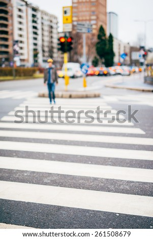 intentional blurred city and people urban milan scene background -  - stock photo