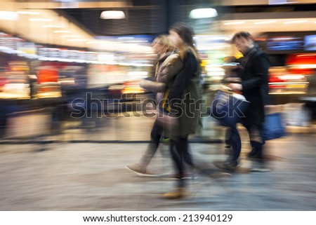 Intentional Blurred Image of Young People in Shopping Center  - stock photo