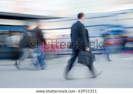 Intentional motion blurred image of businessman rushing to office in the morning - stock photo