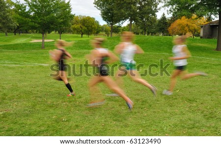 Intentionally Blurred Image of Girls Running at a High School Cross Country Meet - stock photo