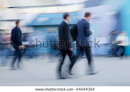 Intentionally blurred image of two businessman rushing to office in the morning - stock photo