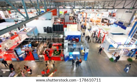 Intentionally blurred trade show background - stock photo