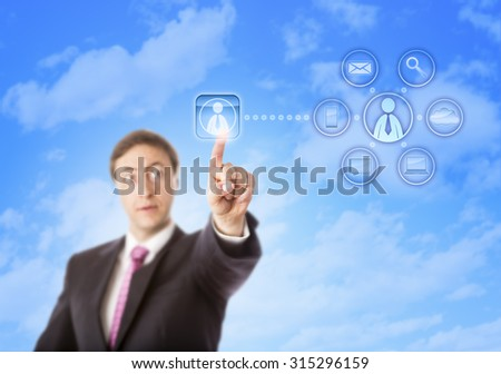 Intently looking corporate consultant is touching an interface key to contact a zero-hours contractor in cyberspace. Concept for outsourcing, subcontracting, delegating and plug-and-play workers. - stock photo