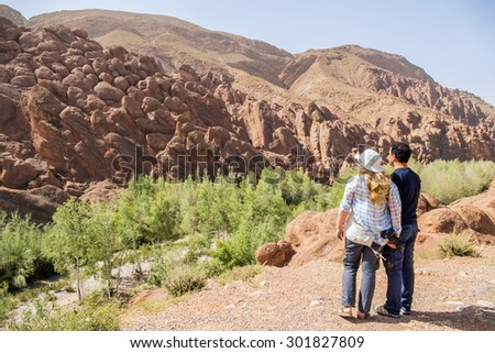 Inter ethnic couple of tourists in Dades Gorges, Morocco - stock photo
