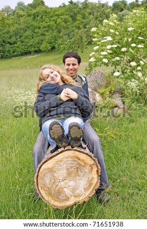 Inter-ethnic couple relaxing outdoor - stock photo