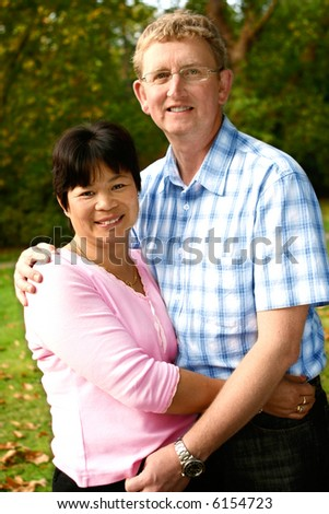 Inter married couple from Thai and English background, enjoying a day in the park.