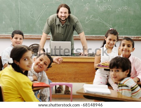 Interaction between male teacher and children, funny class in school - stock photo